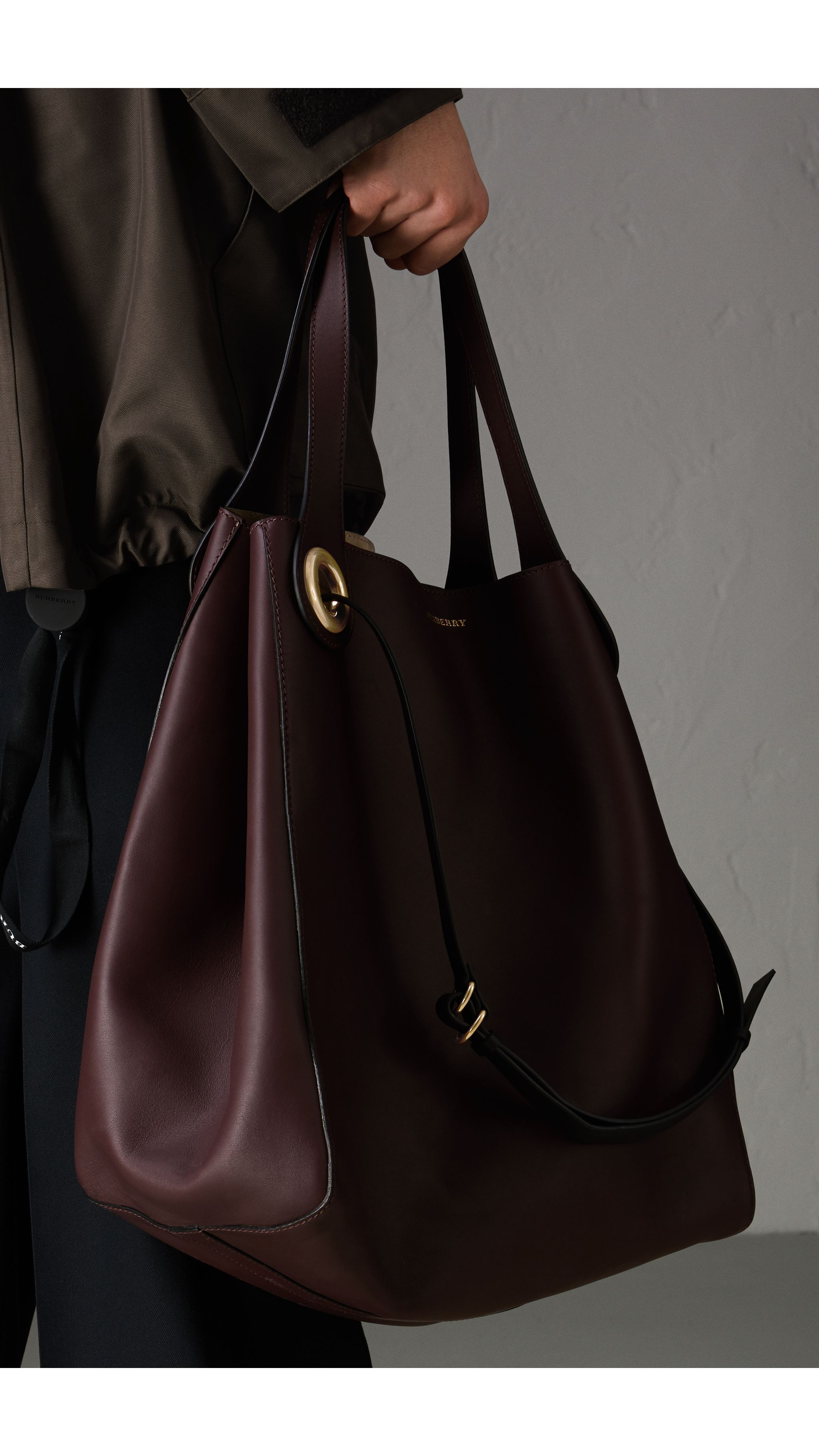 783beb80ad The Large Leather Grommet Detail Tote in Deep Claret