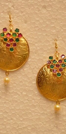 Ethnico Golden Round Earring With Fl Design
