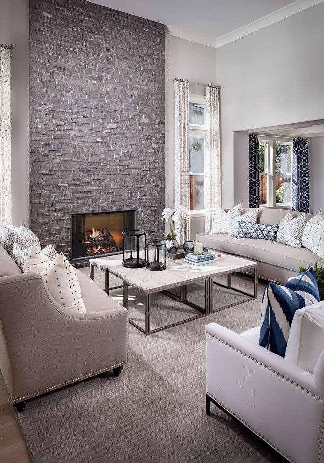 The Floor To Ceiling Stone Fireplace Is The Focal Point Of