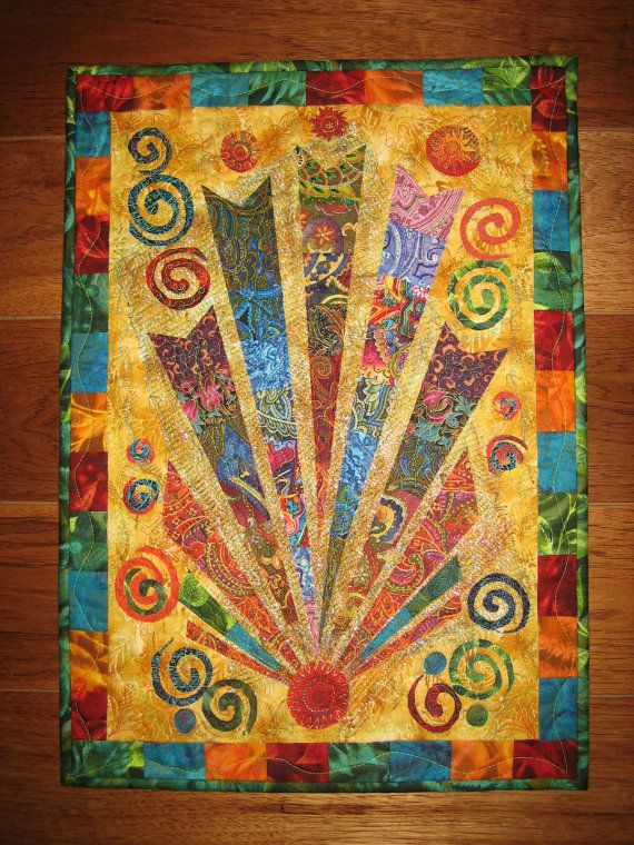 Looks like a celebration!  http://www.etsy.com/listing/94387217/art-quilt-color-burst-mardi-gras-wall?ref=sr_gallery_42_search_query=Quilt_view_type=gallery_ship_to=US_page=14_search_type=handmade_facet=handmadeQuilt