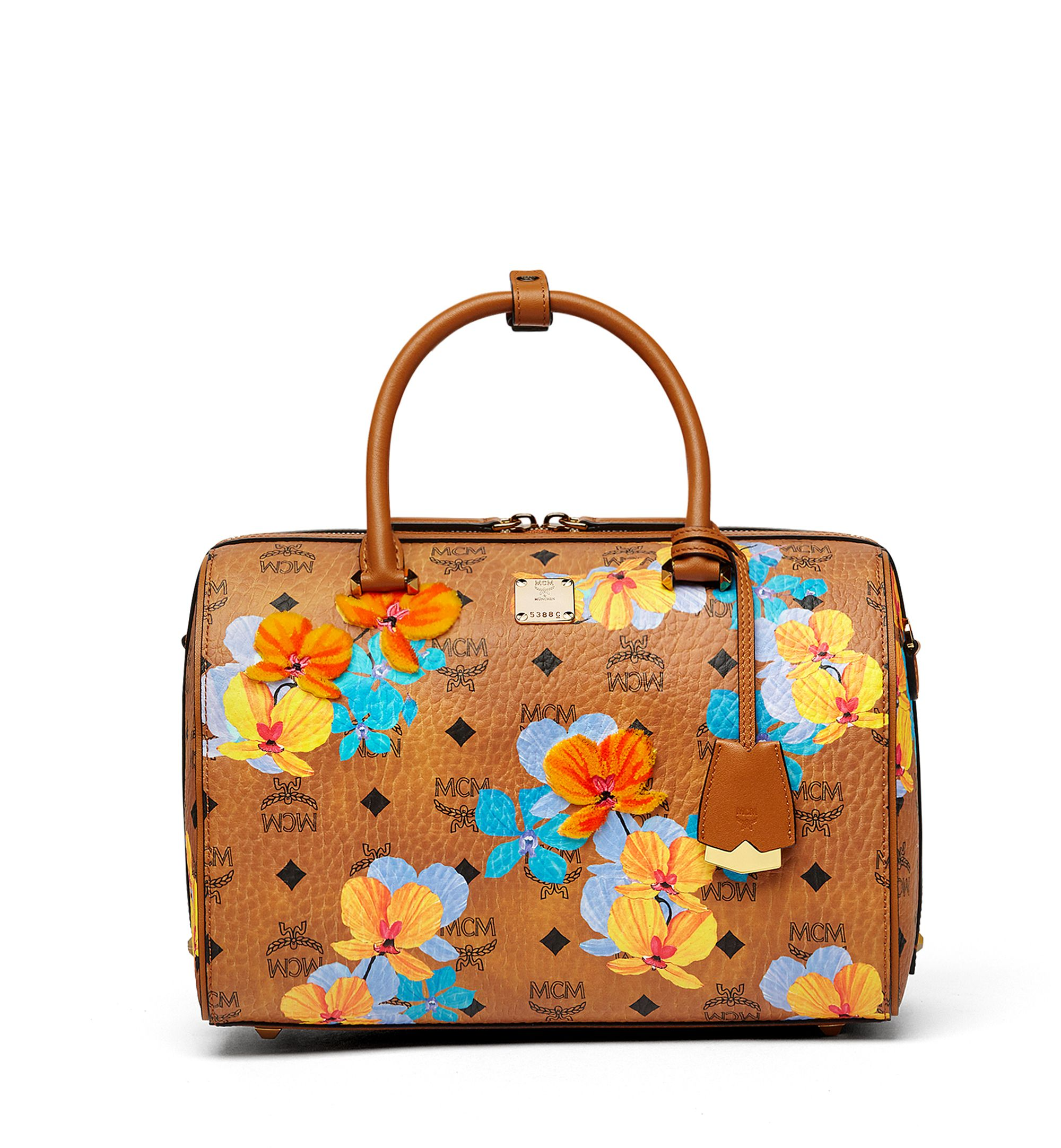 d4a6f96af MCM ESSENTIAL BOSTON BAG IN FLORAL PRINT VISETOS. #mcm #bags #leather  #travel bags #weekend #canvas #