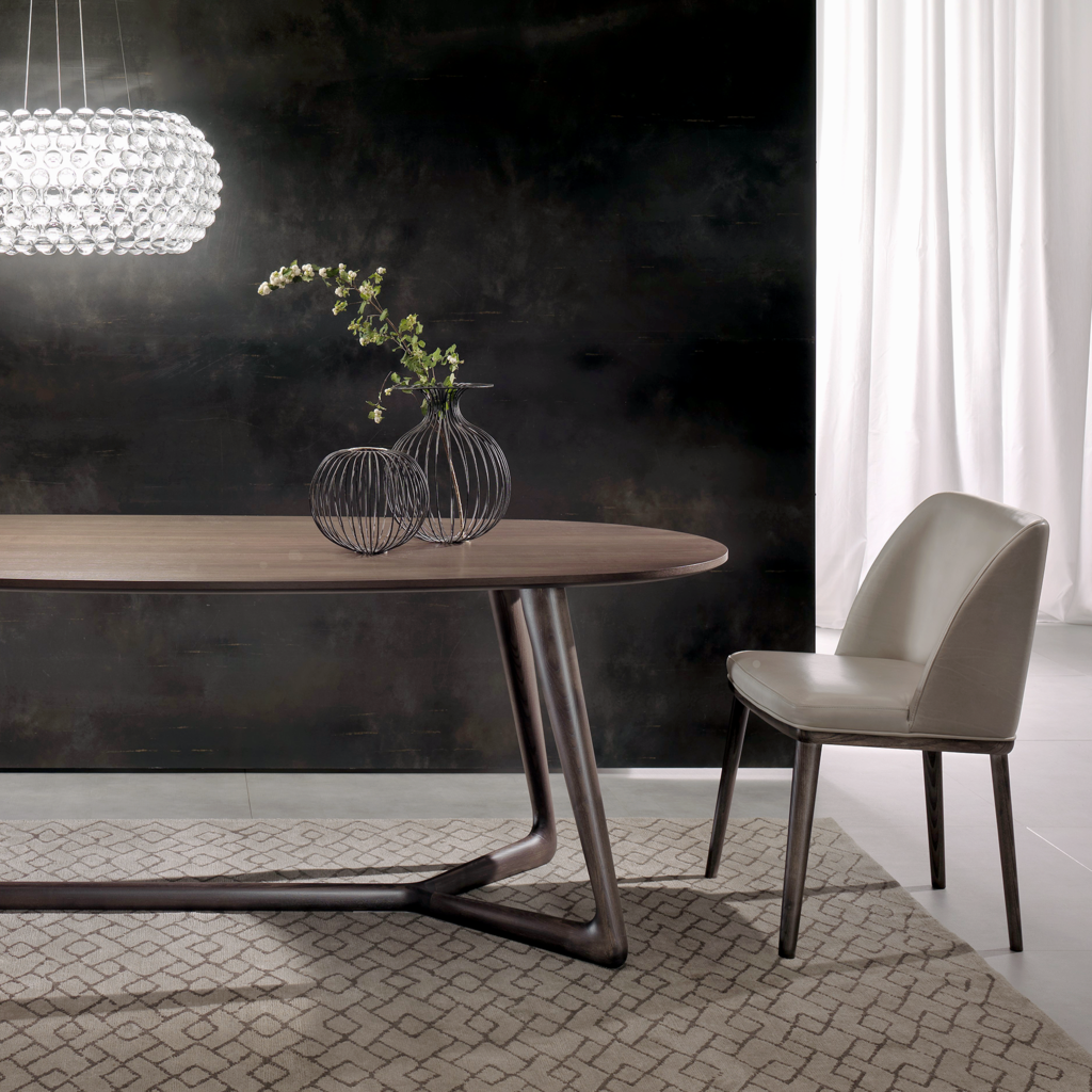 The Cover dining table is made in Italy by highly renowned Pacini e ...