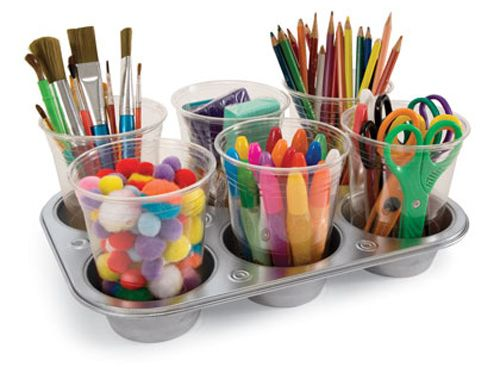 magnets on the bottoms of plastic cups, inside muffin tins. handy storage for craft supplies!