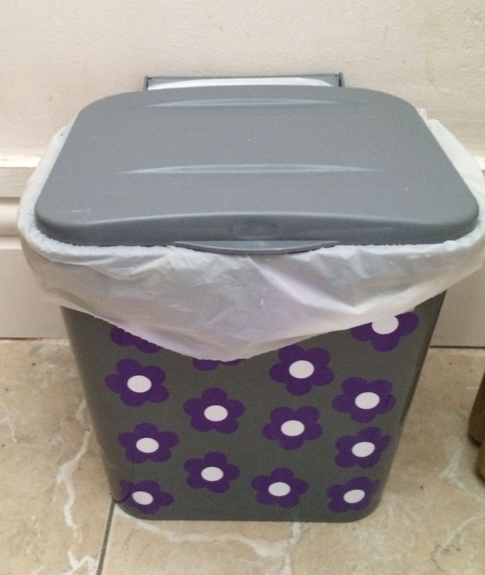 Still in a crazy daisy Mary Quant mood, stickers on food refuse caddy.