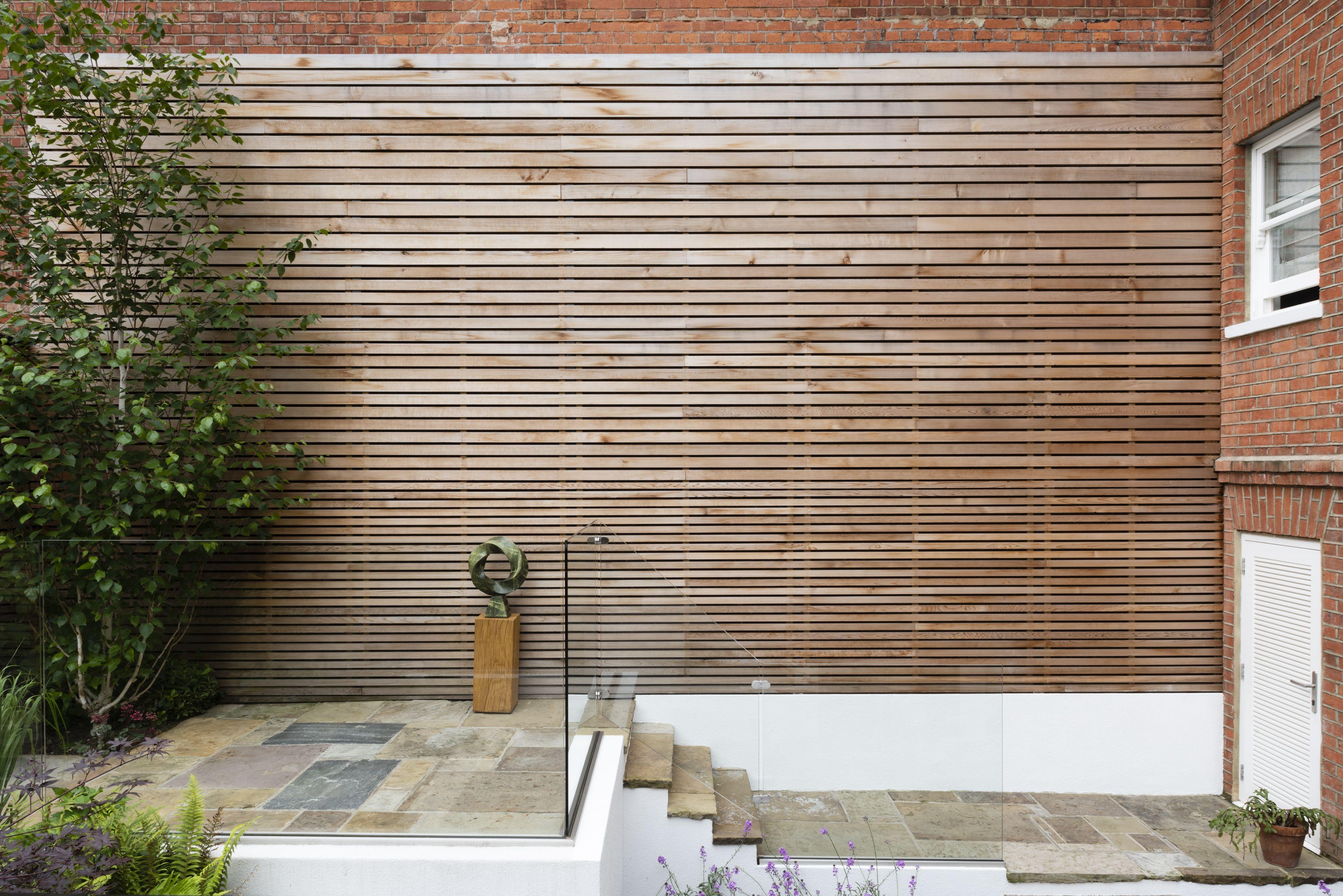 Cedar Hardwood Cladding Of An Exterior Brick Wall Garden Designed By Karen Rogers Krgardendesign Garden Design Small Garden Design Exterior Brick