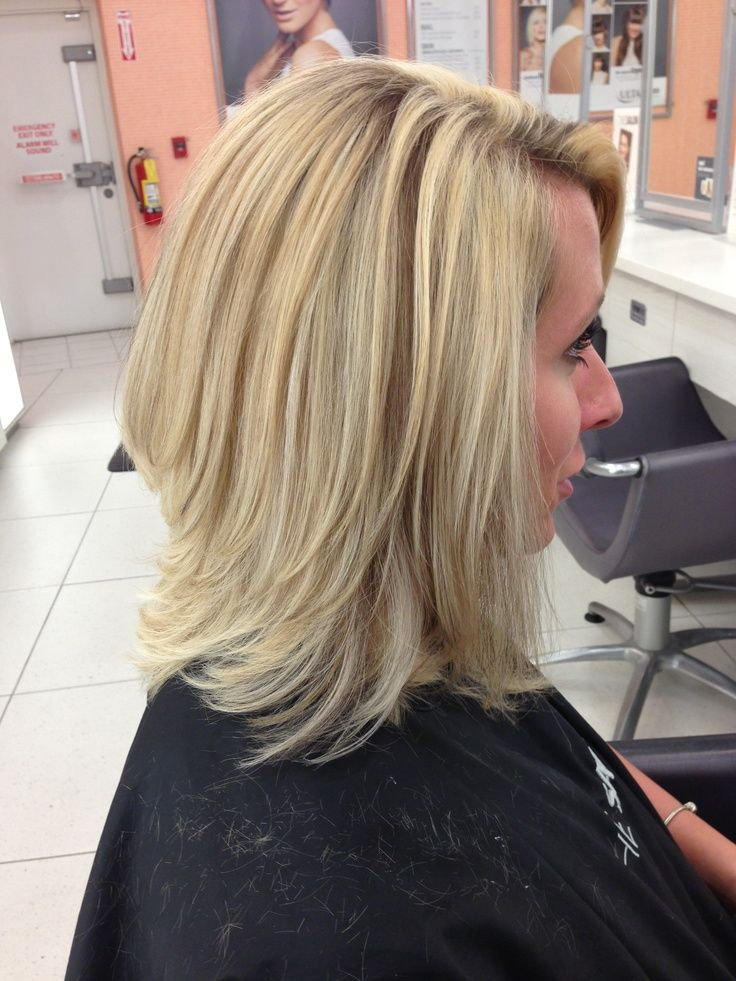Barely There Angled Long Bob With Layers Highlighted With A Few Long