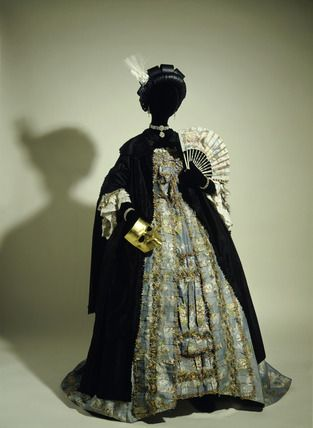 Masquerade costume A black silk domino cloak with gold mask worn over a french silk and linen dress c.1765. Museum of London & Masquerade costume: A black silk domino cloak with gold mask worn ...