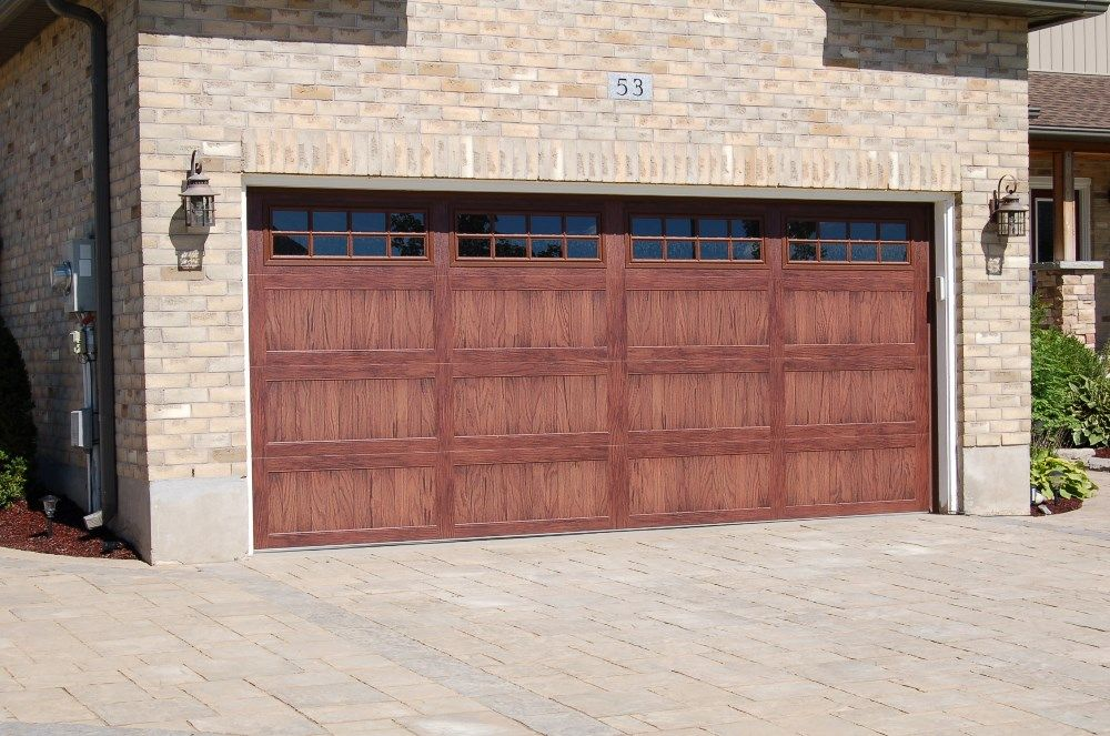 Overhead Doors model 5983 Accents Faux Wood Garage Doors in Dark Oak  Woodtone with Stockton Glass. C H I  insulated garage door model 5983 in dark oak with stockton
