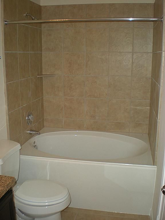 Master bathe with garden tub and shower combo.