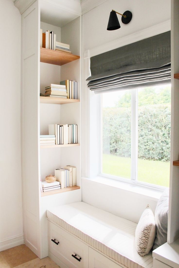 Great window seat bench with pillows, cushion, built in storage and lots of natural light. Window seat nook with drawers and a built in bookshelf. Perfect place to lounge and relax. Home design decor inspiration ideas.