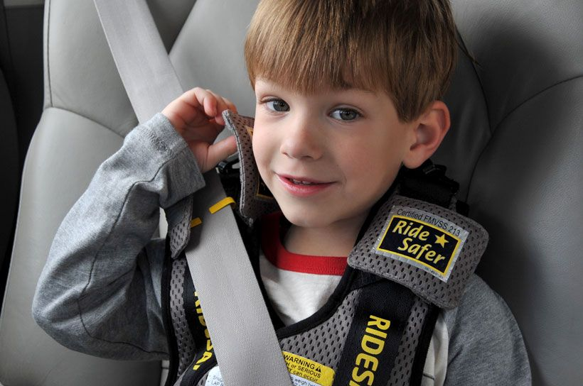 Keeping Schoolaged Kids Safe in Cars with booster seat in