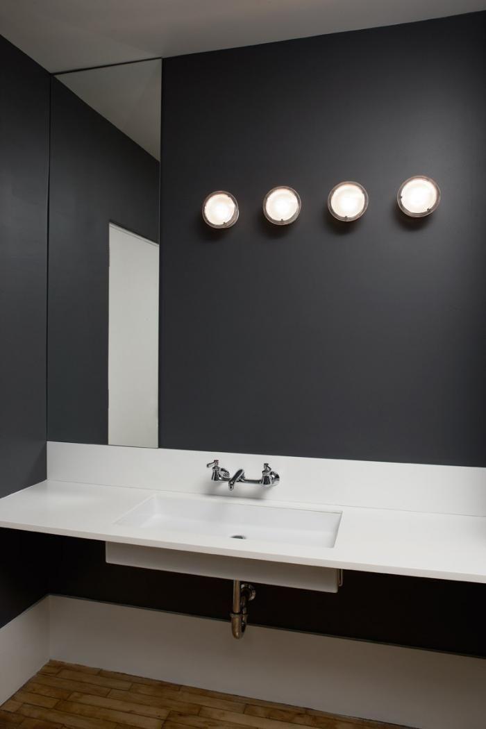 loft bathroom with gray walls, white sink, wood floors, Magdalena Keck
