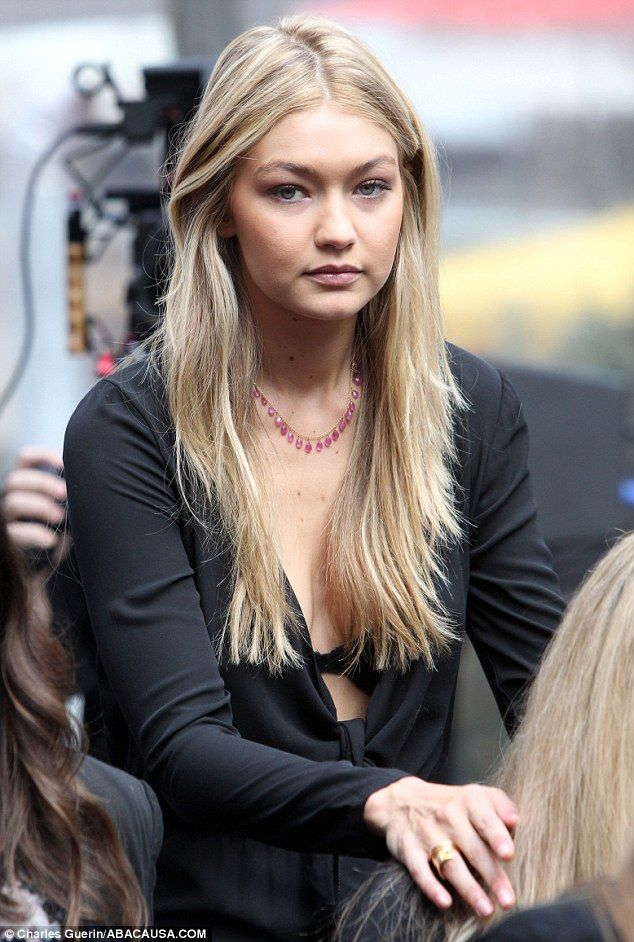 Bit cold there? Gigi Hadid, 19, wore a very low cut top while revealing a black bra as she... #gigihadid