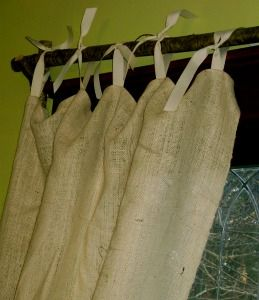 Use a Branch for a curtain rod.