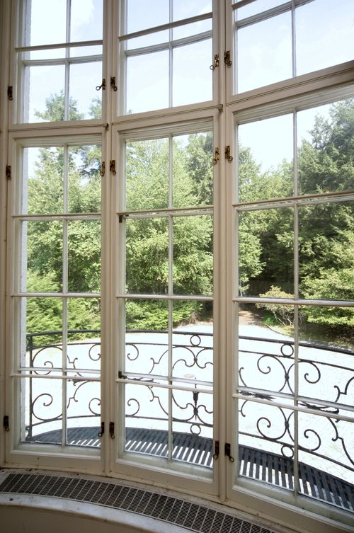 A front window of Le Beau Château, Huguette Clark's country retreat on 52 acres in New Canaan, Connecticut, unlived in since 1951.