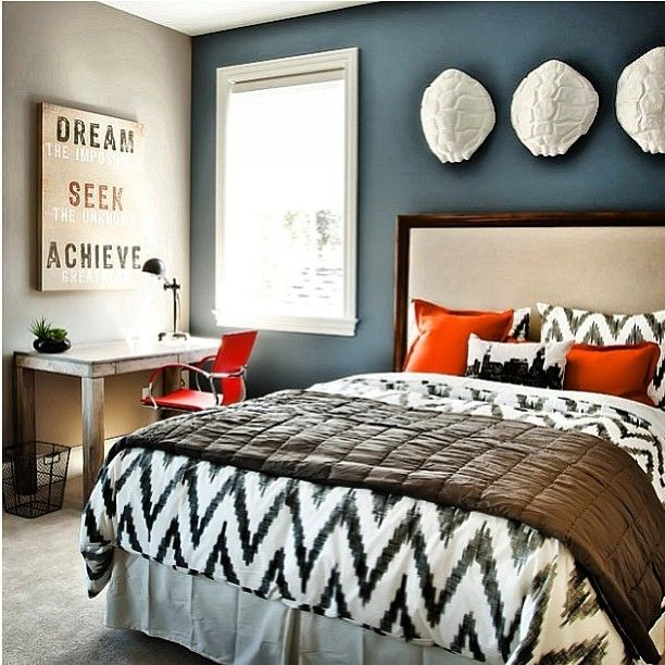 black and white bedding, blue accent wall