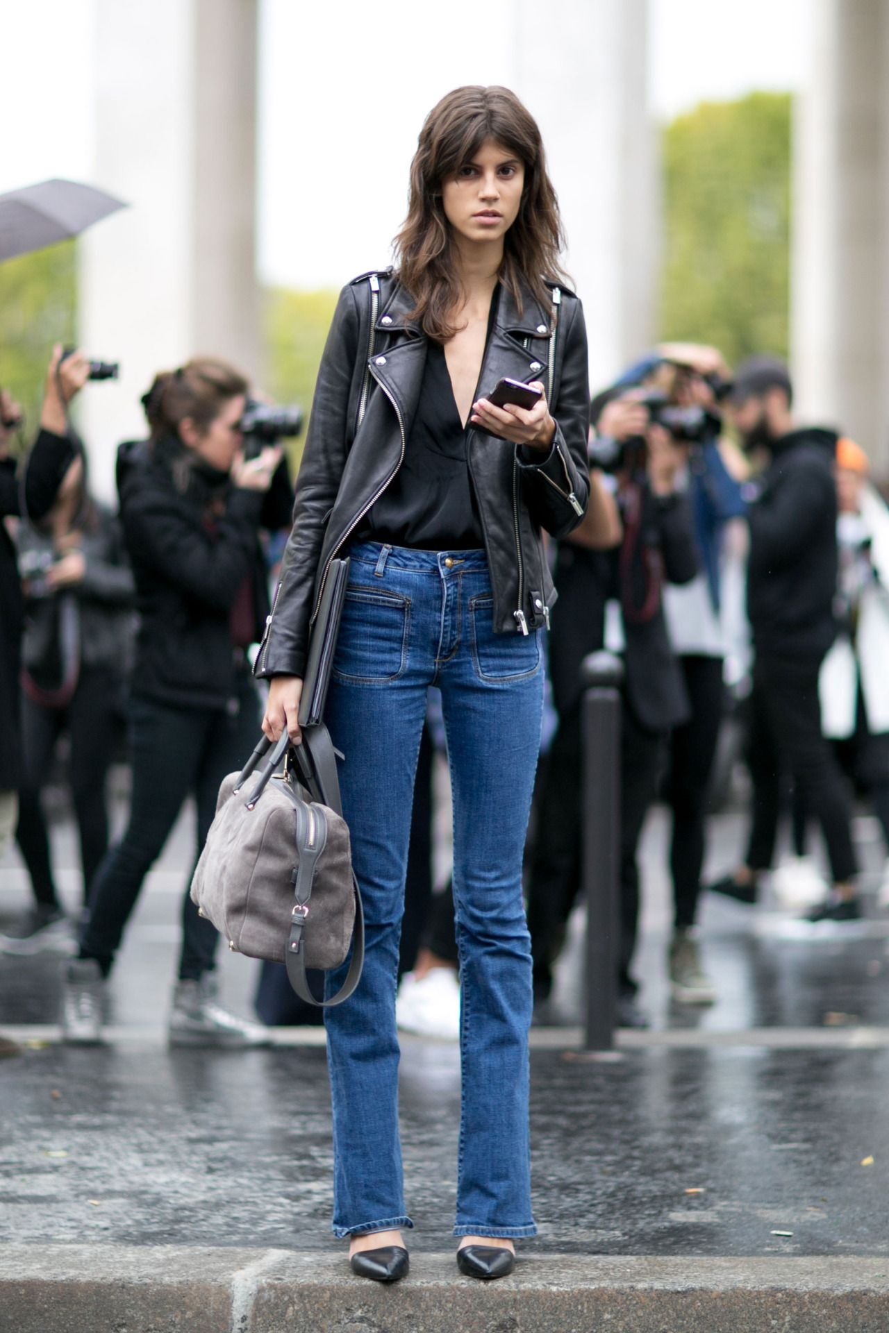 Flared jeans with a leather moto and pointy black flats.
