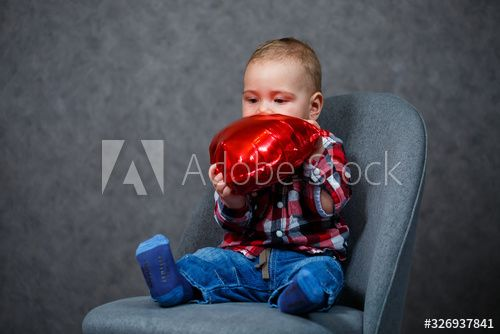 A little boy in a shirt plays with a balloon in the form of a heart , #AD, #plays, #shirt, #boy, #heart, #form #Ad
