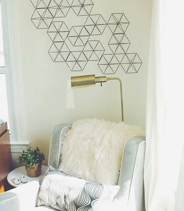 Pin for Later: 55 Real-Life Reading Nooks to Inspire Your Bookish Sanctuary Geometric Accents and Brass Fixtures