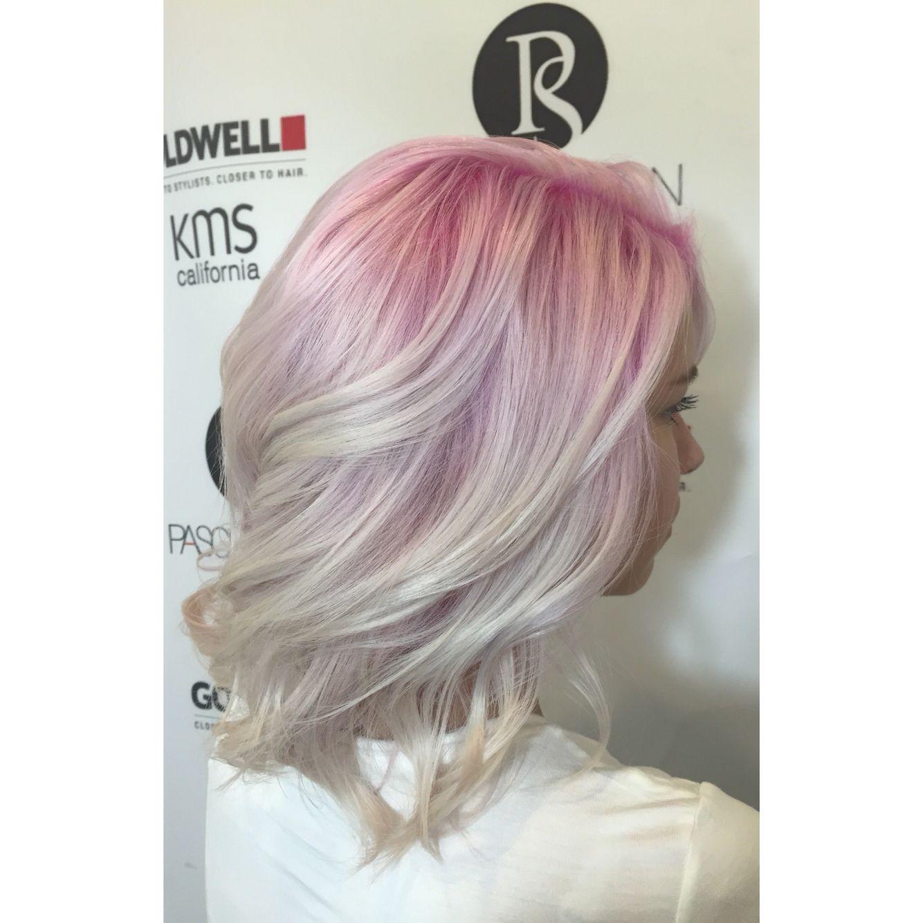 Blush/pink roots on platinum hair.