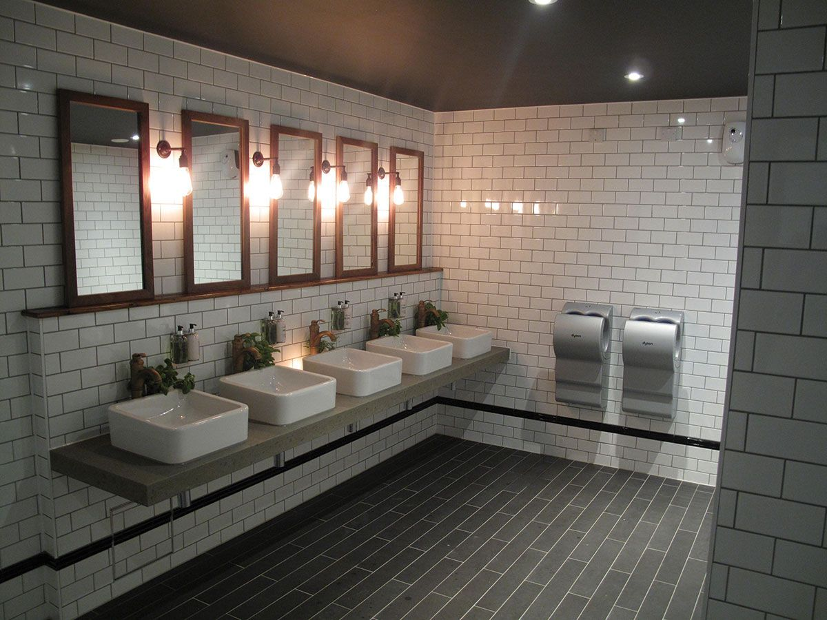 Cool industrial toilet design with stylish subway tiles for Washroom design ideas