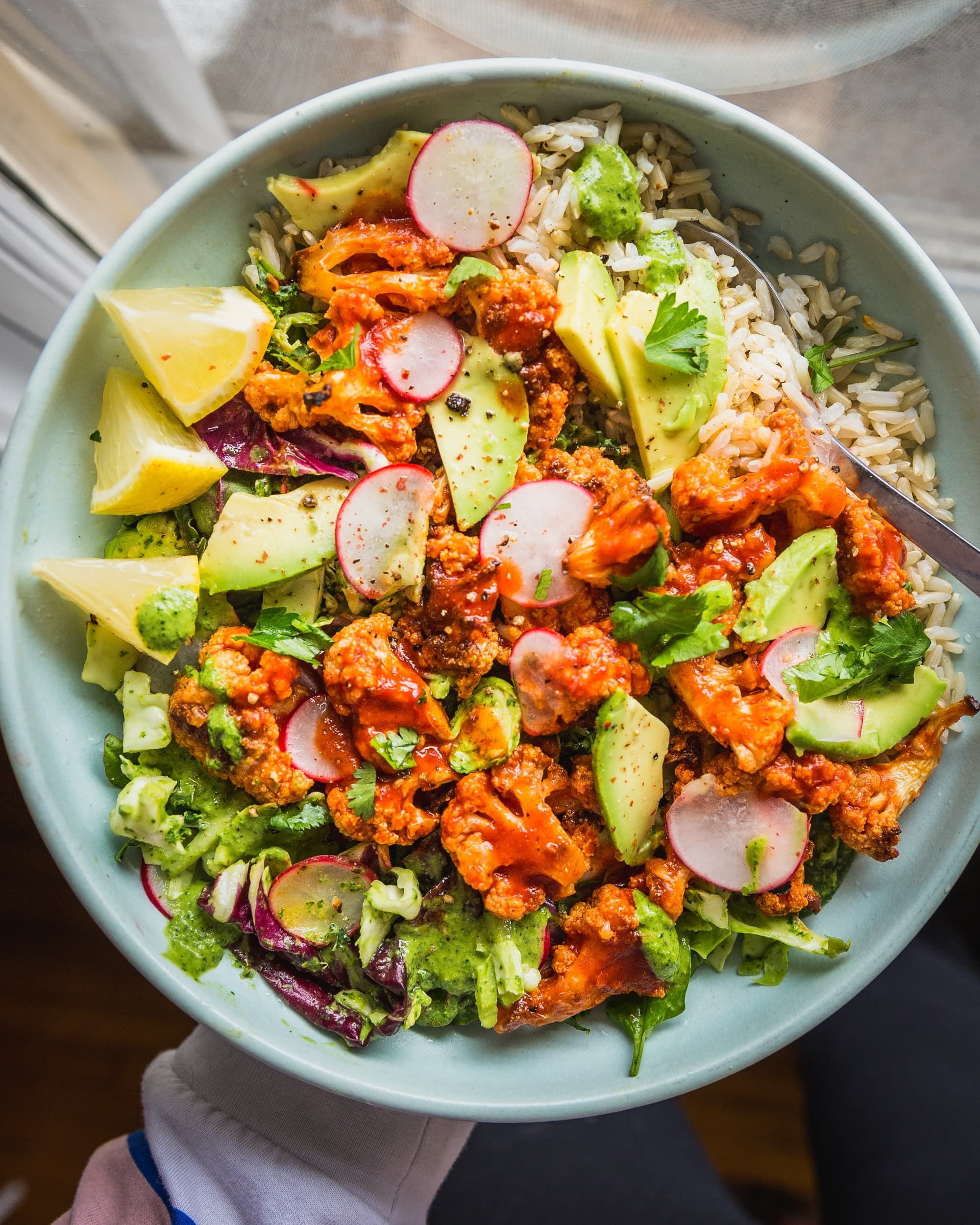Recipe: Spicy Buffalo Cauliflower Bowls with Avocado and Green Tahini