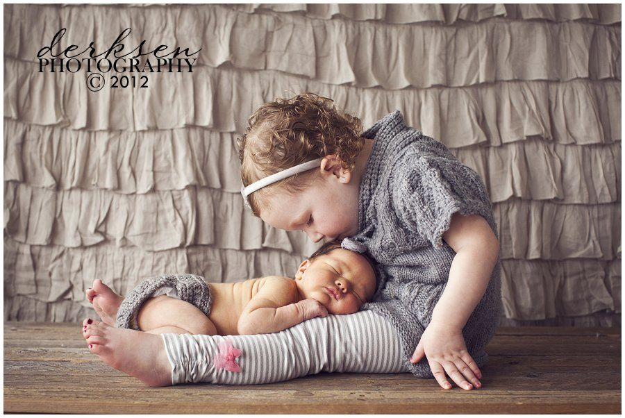 sibling with newborn pose