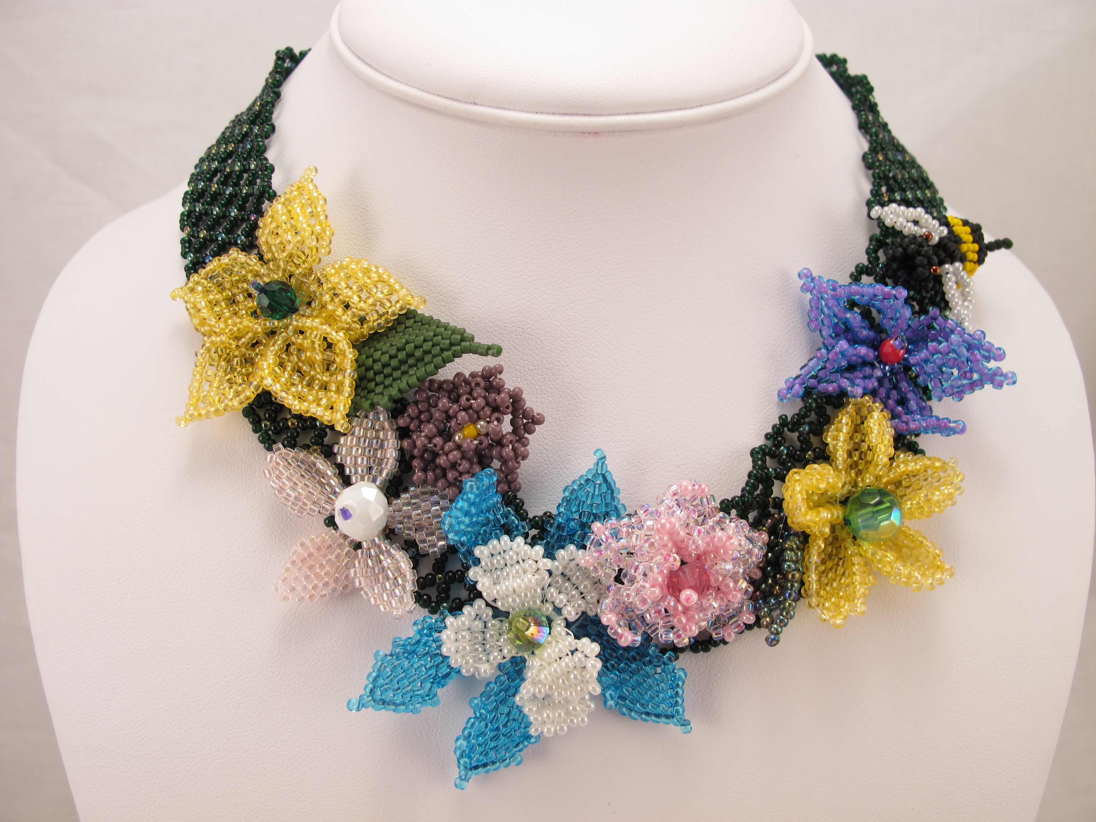 Netted base with beaded flowers made by ME!  https://www.etsy.com/listing/184413955/necklace-netted-base-sporting-a-variety?ref=shop_home_active_2