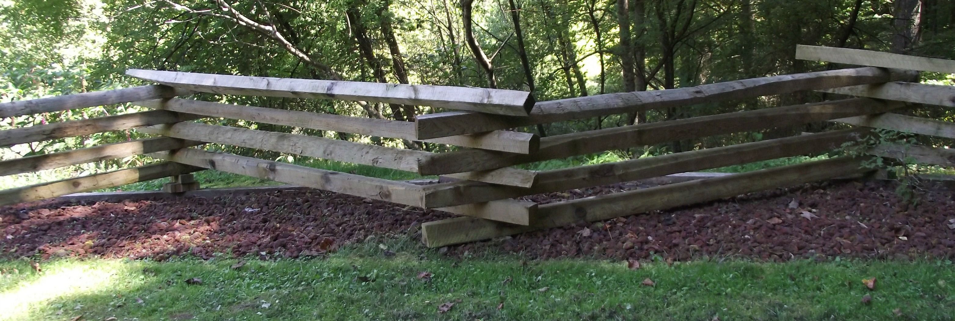 A split-rail fence or log fence, also known as a zigzag fence, worm ...