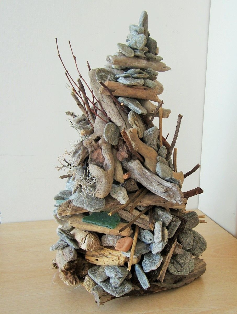 Cairn sculpture in driftwood and stones.