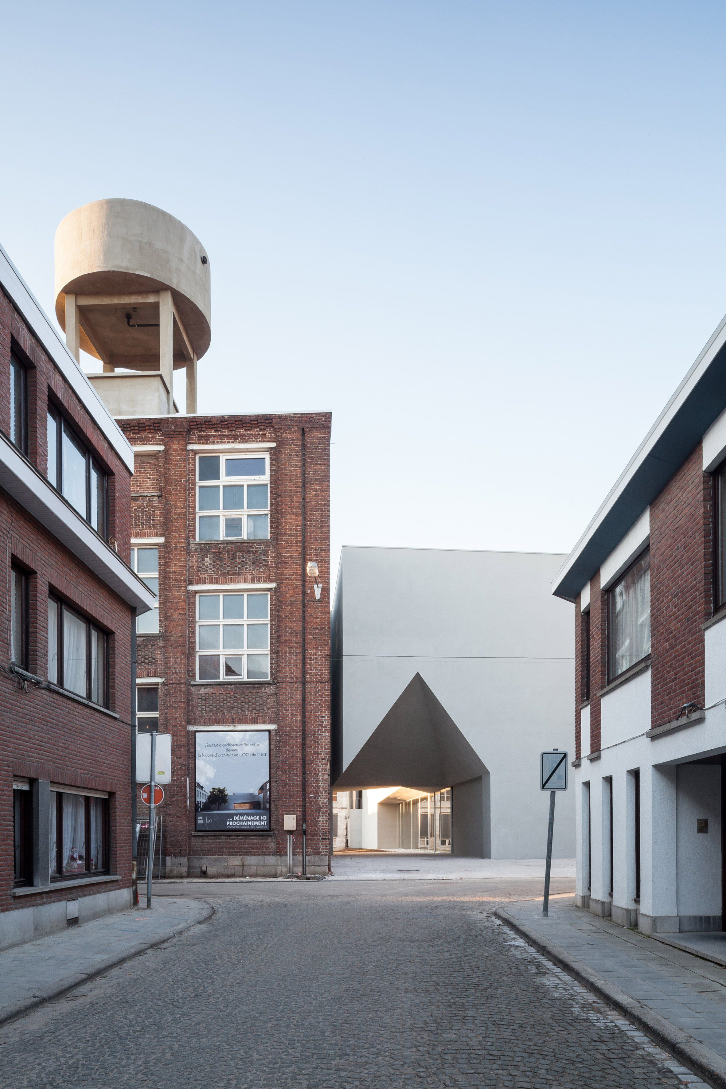 House-shaped void cuts through school of architecture by Aires ...