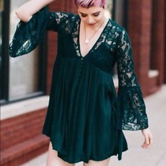 Free people with love from India lace mini dress No slip! No flaws. Worn once. Color is emerald. Sold out color! Super cute mini dress with a sheer mesh bodice featuring floral embroidery. V-Neckline with a dramatic flare bell sleeve and buttondown closure detailing. Crinkly skirt in an effortless, swingy fit with pleating. Free People Dresses Mini