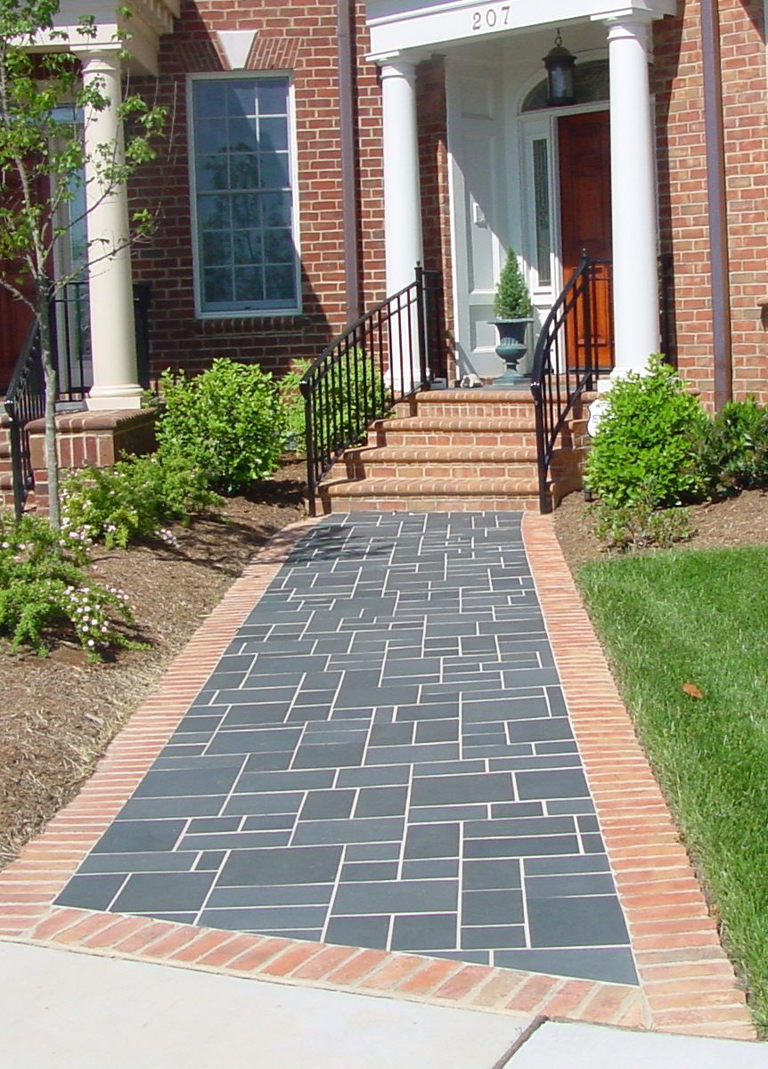 Create A Stately Entrance With A Slate Tile Patterned Walkway Neuse Tile S Installation Know How Ensures This Ou Outdoor Tiles Tile Installation Entrance Ways