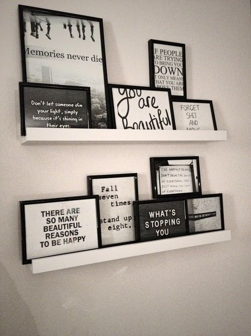I love how the frames are all different sizes, and set on the shelves