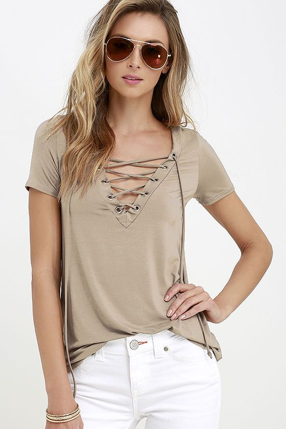 83e0e990662 It s time to sit back and slip on the Enjoy the Ride Taupe Lace-Up Top!  Super soft jersey knit (in a beige-y taupe) shapes a lace-up V neckline