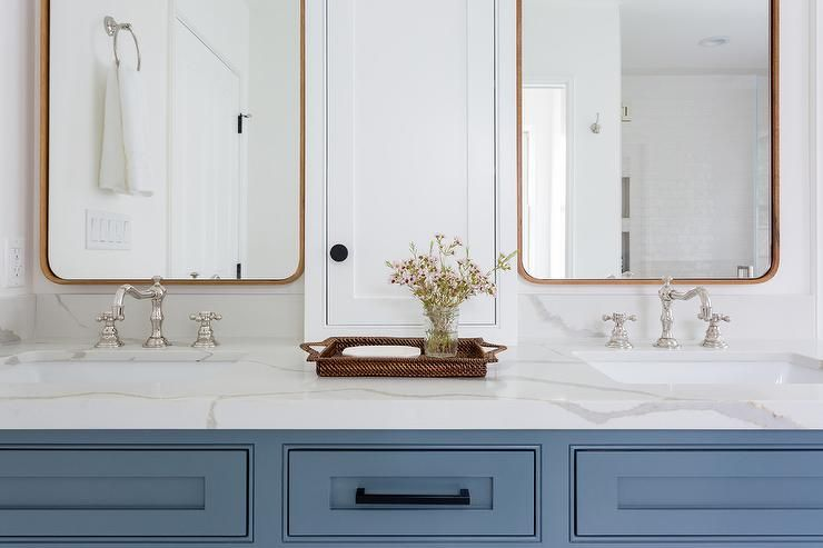 A Woven Blue Tray Sits On A White Quartz Countertop Accenting A