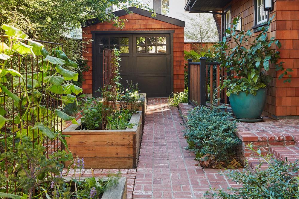 This Family S Lush Landscape Is Full Of Small Space Edible Gardening Ideas Edible Garden Fun Garden Art Whimsical Garden Art