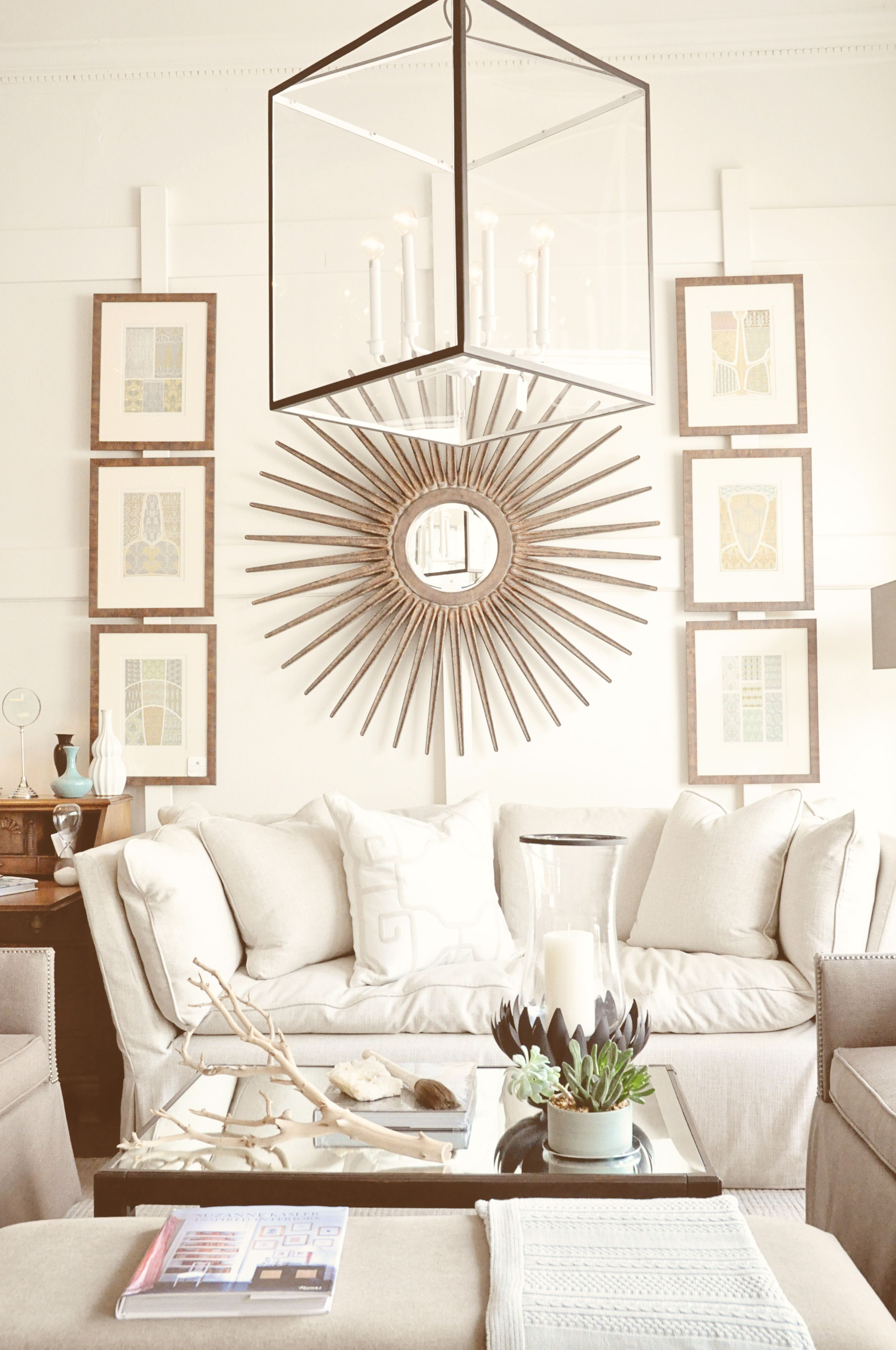 Living Rooms · Round Mirror With Art On Either Side