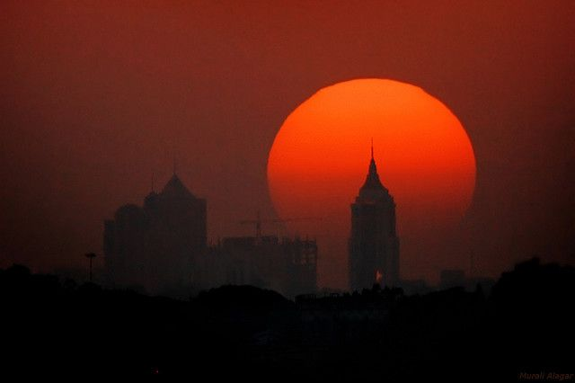 Bangalore Blessed    Sun setting right behind UB towers and blessing Bangalore. Photo  by Muralidharan Alagar.