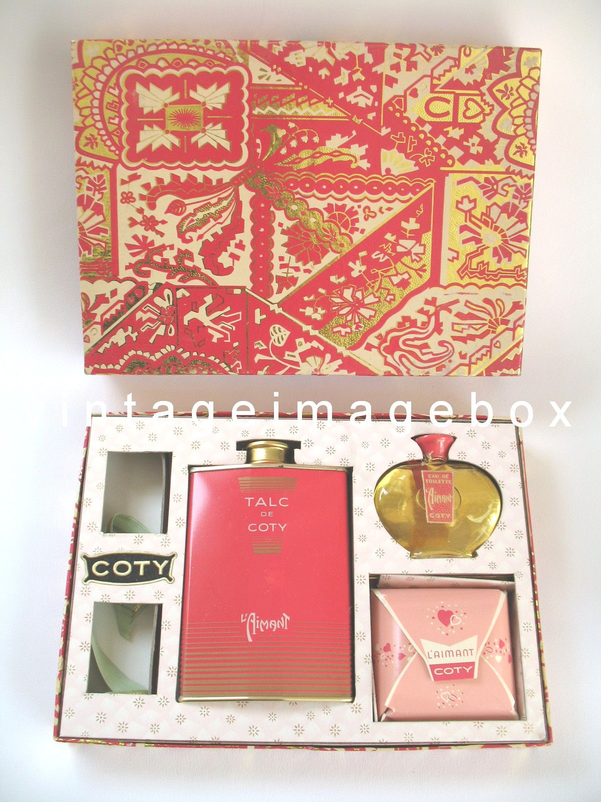 Vintage L'Aimant set by Coty. Mini perfume, talc and soap set. From VintageImageBox