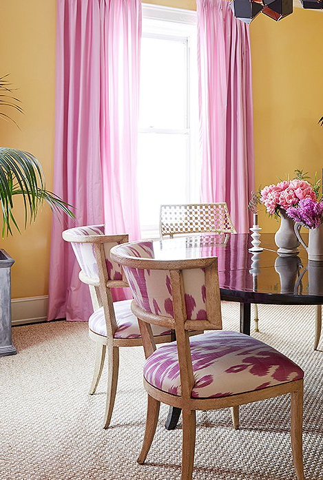 Vibrant Mango Wall Paint Contrasts Beautifully With Bright Bubblegum Pink Floor To Ceiling Curtainatching Ikat Print Dining Chairs In Amanda Nisbet S