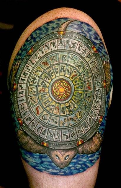 This is almost like the scribes tattoos, but with #StarGate | That's a lot of shoulder #Ink.