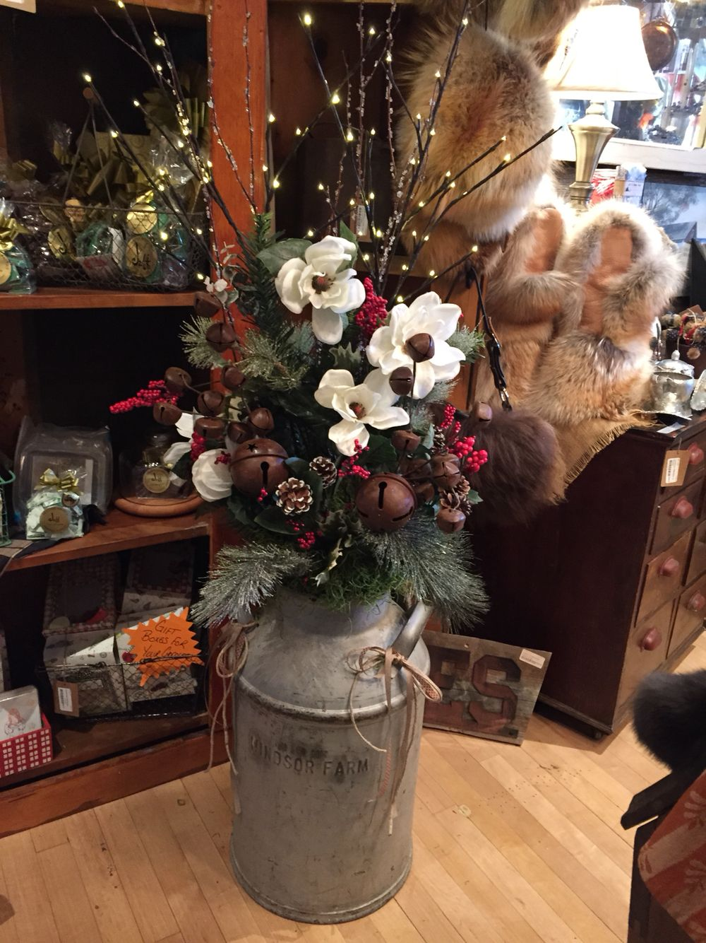 Antique cream can with Christmas floral arrangement and battery operated  twig lights. Perfect for your