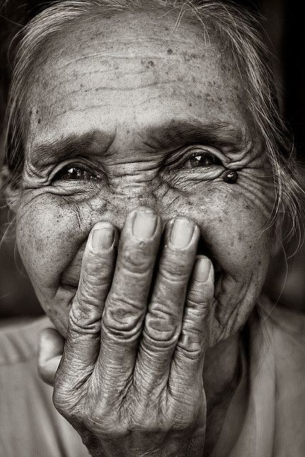 I like this photograph due to how natural the model is in the image and how the photographer has made a strong connection here in order to make the woman laugh. I also love the woman's eyes and how they tell her story as a person.