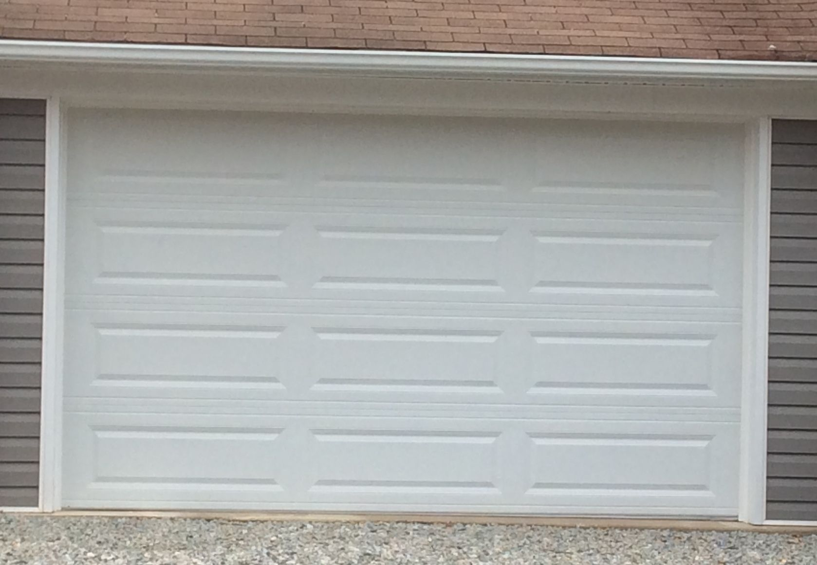 12x7 Model 4251 Raised Long Panel Steel Garage Door Installed By The Richmond Store Garage Door Panels Door Installation Garage Door Hardware