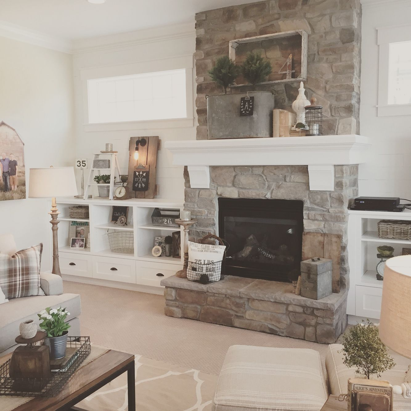 Farmhouse Fireplace Ideas: White Plank Walls Surround This Stone Fireplace For A