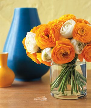 A clear hair elastic binds blooms together for a better arrangement in a wide-mouth vase. Stretch the elastic around the stems, then let the flowers fall naturally.