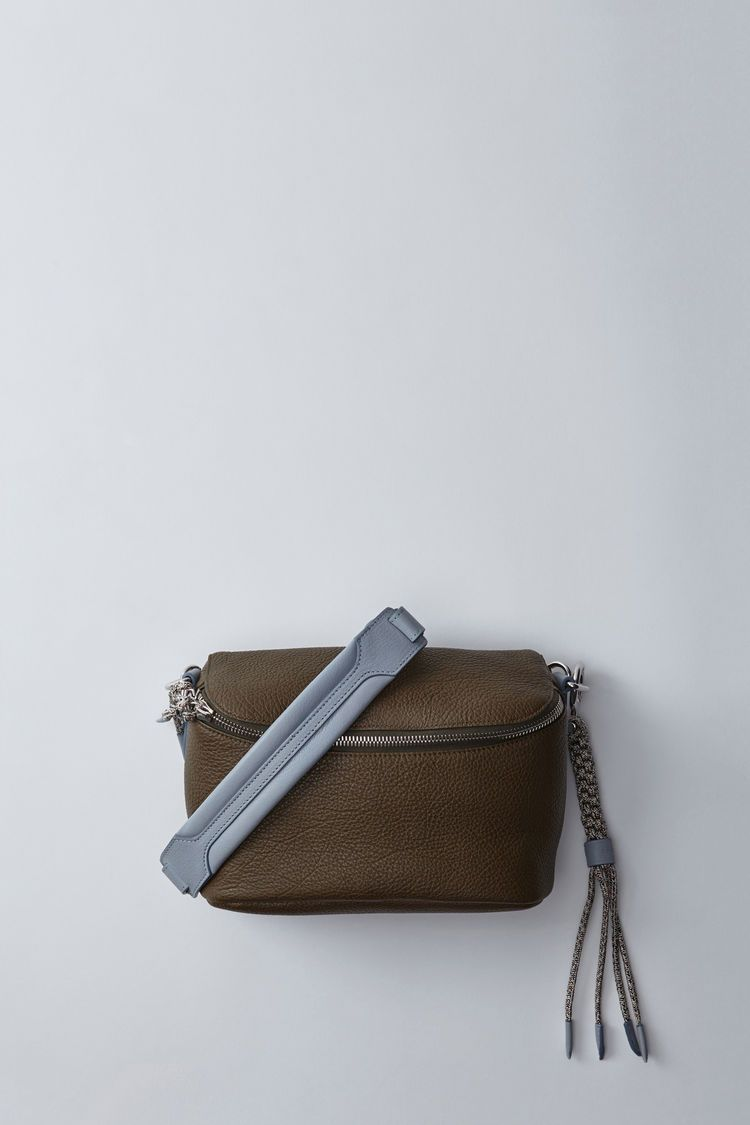 Acne Studios Rope Hip oil green/light blue is a leather hip bag with two tone rope lanyard.