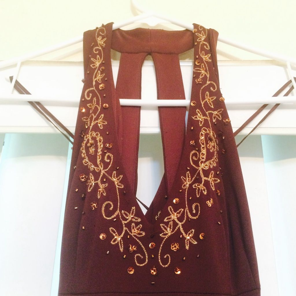 Dark brown dress with gold embezzlement accents products