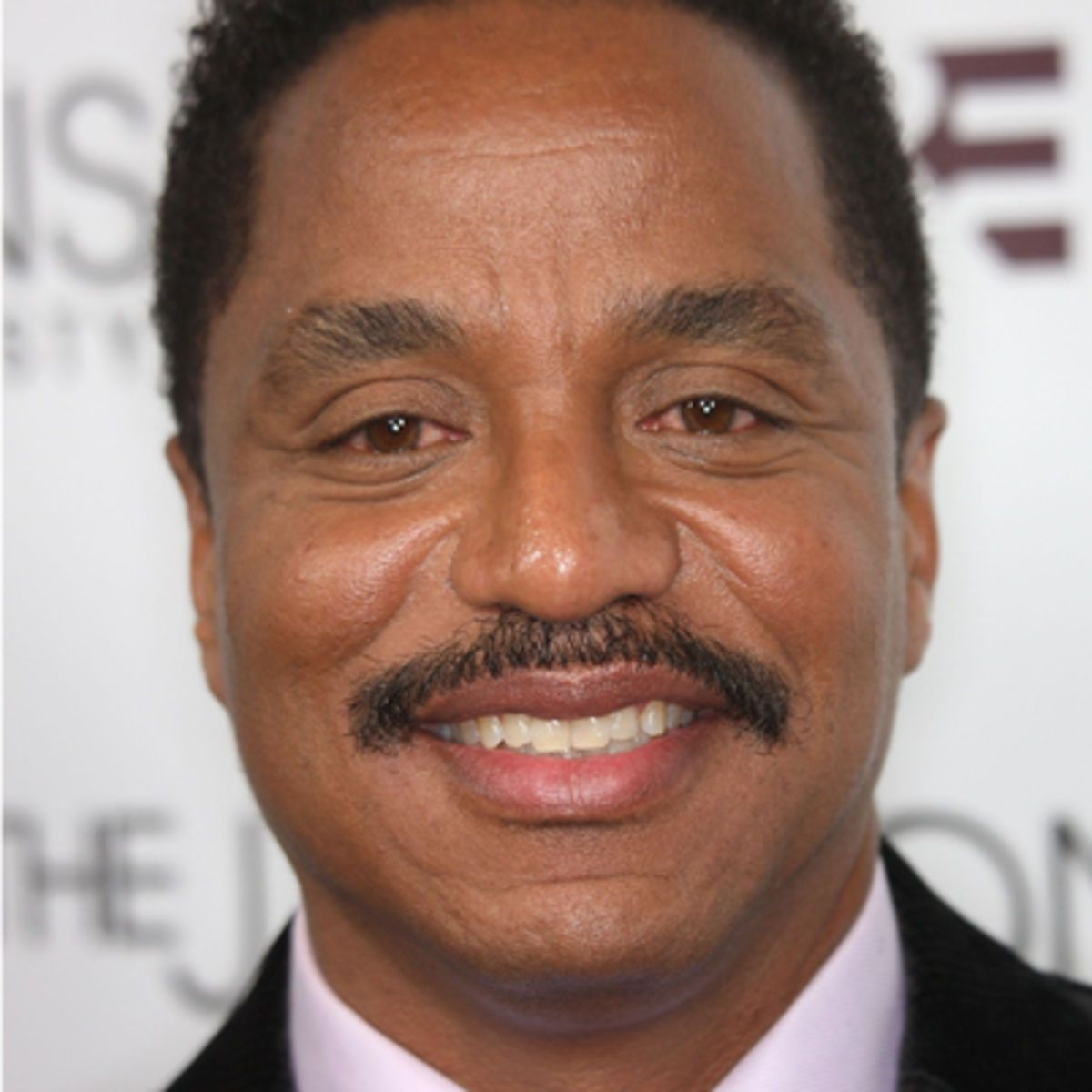 Marlon Jackson  - 2019 Dark brown hair & chic hair style.